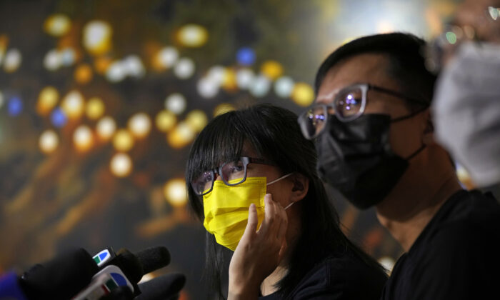 Chow Han Tung (L), vice chairwoman of the Hong Kong Alliance in Support of Patriotic Democratic Movements of China, and other group members attend a news conference in Hong Kong, on Sept. 5, 2021. (Kin Cheung/AP Photo)