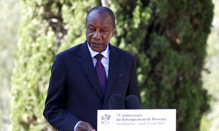 Guinean President Alpha Conde delivers a speech during a ceremony marking the 75th anniversary of the WWII Allied landings in Provence, in Saint-Raphael, southern France, on Aug. 15, 2019. (Eric Gaillard/Pool Photo via AP)