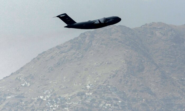 A U.S. Air Force aircraft takes off from the airport in Kabul on Aug. 30, 2021. (Aamir Qureshi/AFP via Getty Images)