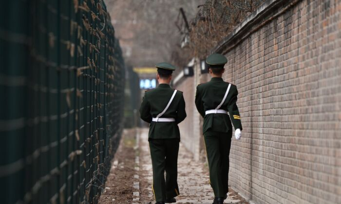 Chinese paramilitary police officers patrol in Beijing on March 28, 2018. (Greg Baker/AFP via Getty Images)