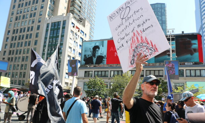 People march in downtown Toronto in protest of Ontario's COVID-19 vaccine mandate, on Sept. 4, 2021. (Andrew Chen/The Epoch Times)