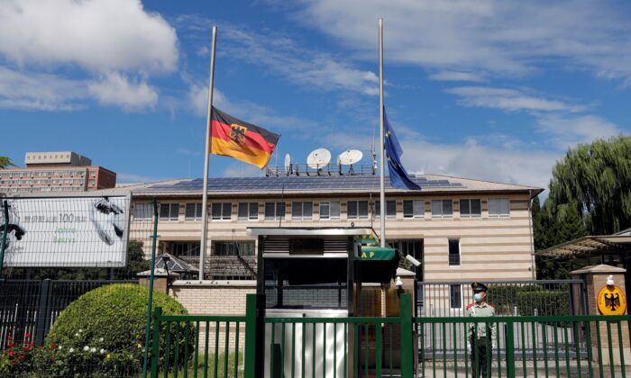 German and European Union flags fly at half mast after German ambassador to China Jan Hecker passed away, at the Germany embassy in Beijing, China, on Sept. 6, 2021. (Carlos Garcia Rawlins/Reuters)