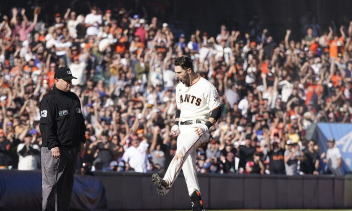 San Francisco Giants' Steven Duggar celebrates after hitting a two-run triple against the Los Angeles Dodgers during the second inning of a baseball game in San Francisco on Sept. 5, 2021. (AP Photo/Jeff Chiu)