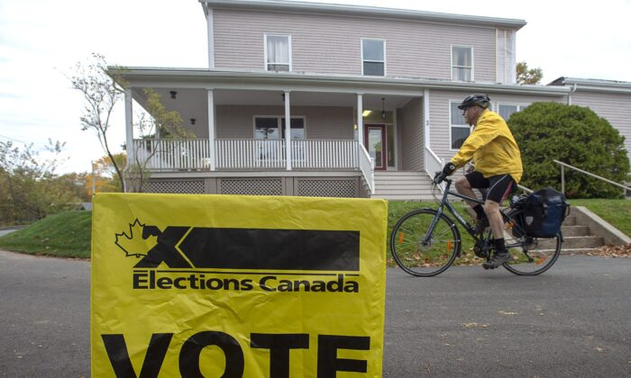 A voter rides away after casting his ballot in the 2019 federal election, in Dartmouth, N.S., on Oct. 21, 2019. (The Canadian Press/Andrew Vaughan)