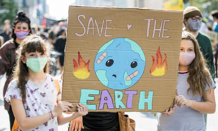 Children take part in a climate change protest in Montreal on Sept. 26, 2020. (The Canadian Press/Graham Hughes)