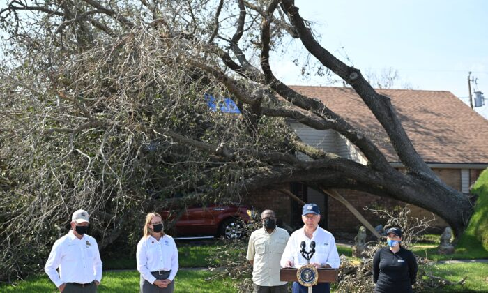 """President Joe Biden delivers remarks after touring the Cambridge neighborhood affected by Hurricane Ida, in LaPlace, Louisiana, on Sept. 3, 2021. Biden has attributed the severity of storms like Ida to the """"climate crisis."""" (Mandel Ngan/AFP via Getty Images)"""