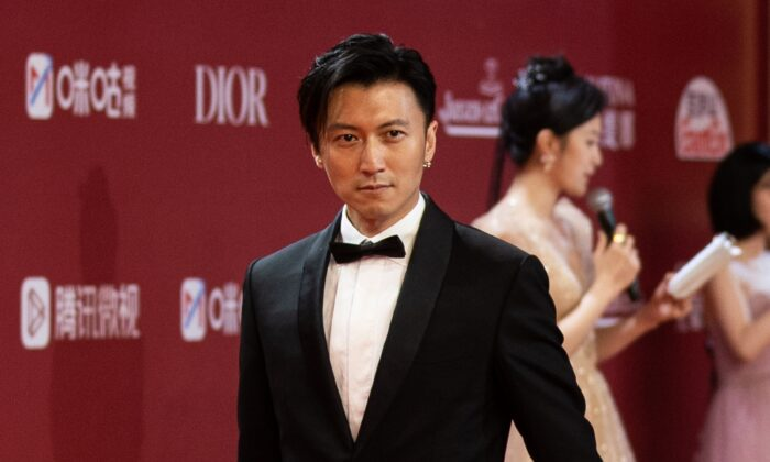 Actor Nicholas Tse Ting-fung walks on the red carpet during the opening ceremony of 24th Shanghai International Film Festival in Shanghai, China on June 11, 2021. (Yves Dean/Getty Images)