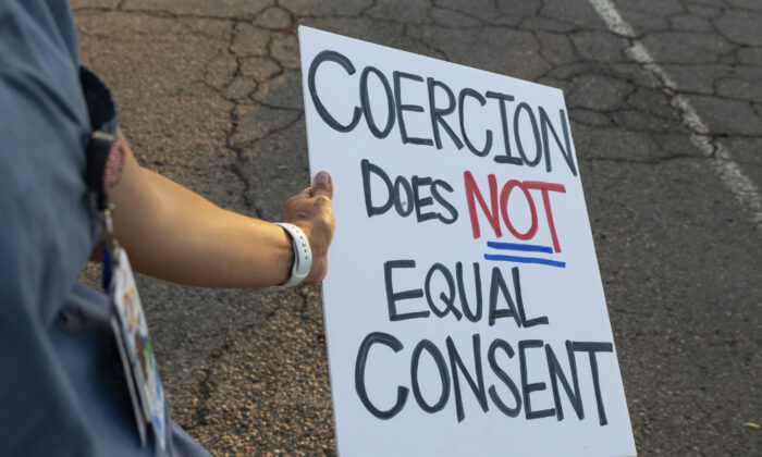 Orange County nurses choosing not to receive coronavirus vaccinations gather in Huntington Beach, Calif., on Sept. 2, 2021. (John Fredricks/The Epoch Times)