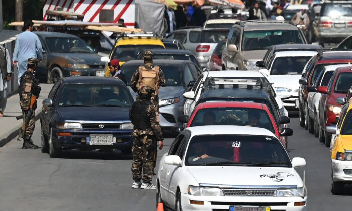 Taliban fighters stand guard as they check commuters at a road checkpoint in Kabul on Sept. 4, 2021. (Aamir Qureshi/AFP via Getty Images)