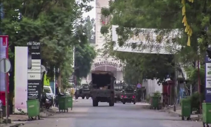 In this image made from video, a military truck is seen near the presidential palace in the capital Conakry, Guinea on Sept. 5, 2021. (AP Photo)