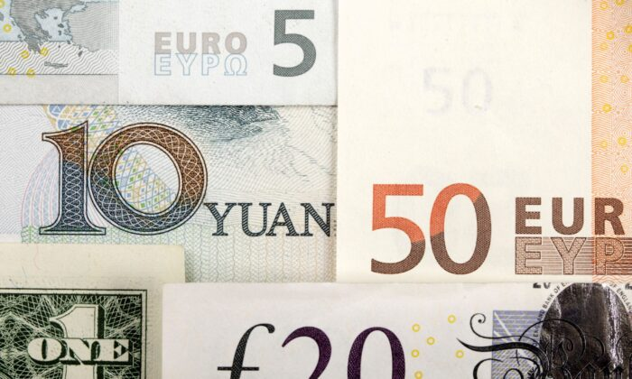 Arrangement of various world currencies including Chinese yuan, U.S. dollar, Euro, British pound, pictured on Jan. 25, 2011. (Kacper Pempel/Illustration/Reuters)