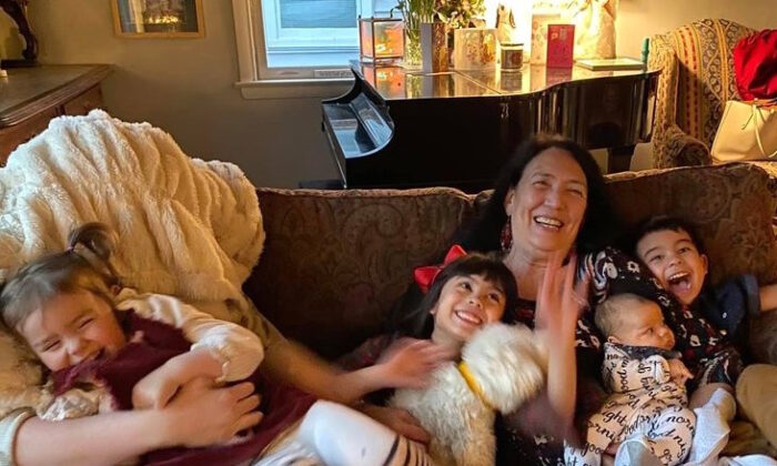 Anita Sherman delights in her grandbabies. Here they share the couch and much laughter. Pictured (L-R) Ada, Maria, Anita, Harrison and Piers. (Courtesy of Anita Sherman)