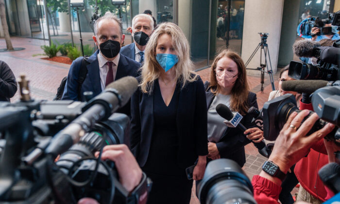 Former Theranos CEO Elizabeth Holmes arrives for the first day of jury selection in her fraud trial, outside Federal Court in San Jose, Calif., on Aug. 31, 2021. (Nick Otto/AFP via Getty Images)