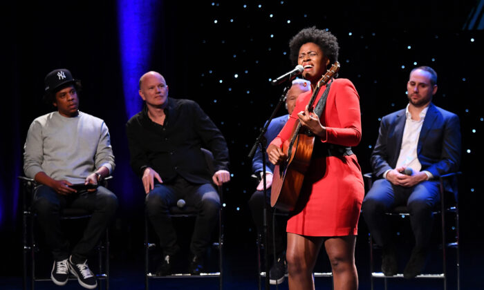 """Victory Boyd performs onstage for Shawn """"Jay-Z"""" Carter, Michael Novogratz, Robert Kraft and Michael Rubin during the launch of The Reform Alliance at John Jay College in New York City on Jan. 23, 2019.  (Nicholas Hunt/Getty Images for The Reform Alliance)"""
