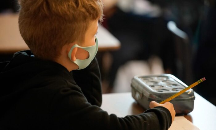 A masked-up student attending class at a U.S. school on Sept. 10, 2020. (George Frey/AFP via Getty Images)