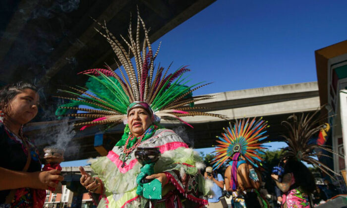 Traditional Aztec dancers prepare to perform at Chicano Park in San Diego on Feb. 3, 2018.  (Sandy Huffaker/AFP via Getty Images)