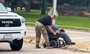 Touching Photo Shows Soldier Helping Man Struggling in Wheelchair Cross Busy Street—And It Goes Viral