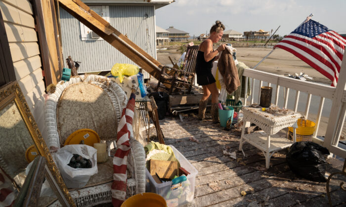Kimberly Szeplaki cleans up her vacation house in the wake of Hurricane Ida in Grand Isle, La., on Sept. 4, 2021. (Sean Rayford/Getty Images)