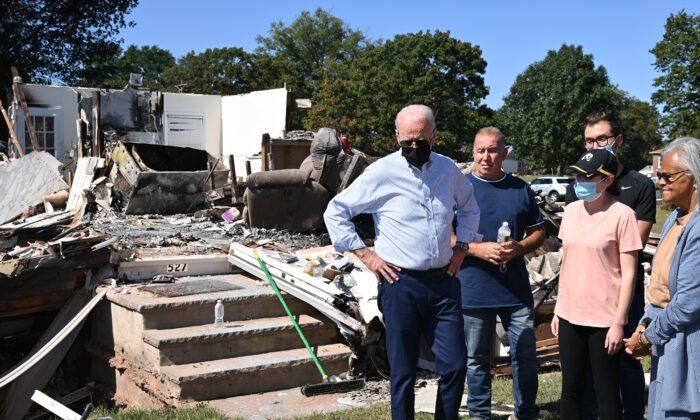 President Joe Biden, center, tours a neighbourhood affected by Hurricane Ida in Manville, N.J., on Sept. 7, 2021. (Mandel Ngan/AFP via Getty Images)