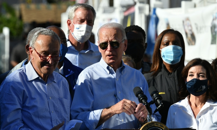 President Joe Biden speaks, flanked by US Senator Chuck Schumer (L) speaks, New York Governor Kathy Hochul (R) and New York Mayor Bill de Blasio (2nd L), during a tour of a neighbourhood affected by Hurricane Ida in Queens, New York on September 7, 2021. (MANDEL NGAN/AFP via Getty Images)