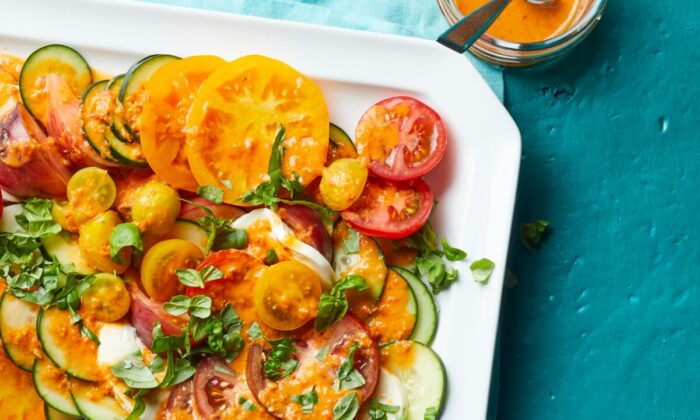 A bold tomato-based dressing completes this light summer salad. (Blaine Moats/TNS)