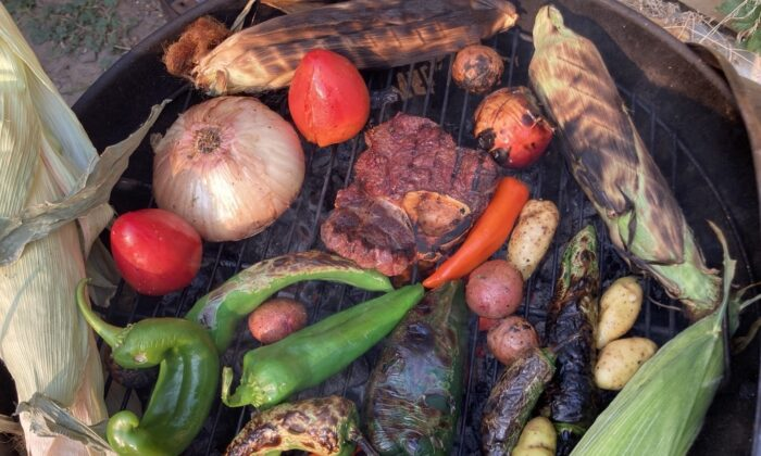 The cool weather of fall is a great time to gather around a warm grill, have a cookout, and make an amazing autumn stew from the leftovers. (Ari LeVaux)