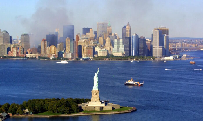 Smoke continues to rise from the destroyed World Trade Center on Sept. 15, 2001. (KEITH MEYERS/AFP via Getty Images)