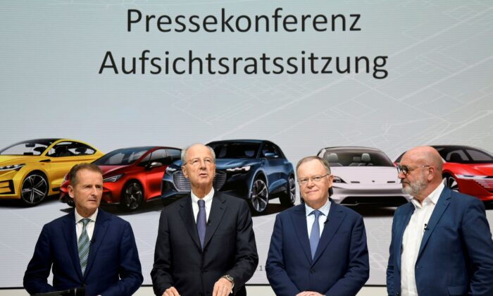 Volkswagen CEO, Herbert Diess, chairman of the supervisory board Hans Dieter Poetsch, Lower Saxony's Prime Minister Stephan Weil and head of VW works council, Bernd Osterloh, address the media after a supervisory board meeting at the Volkswagen plant in Wolfsburg, Germany on Nov. 15, 2019. (Fabian Bimmer/Reuters)