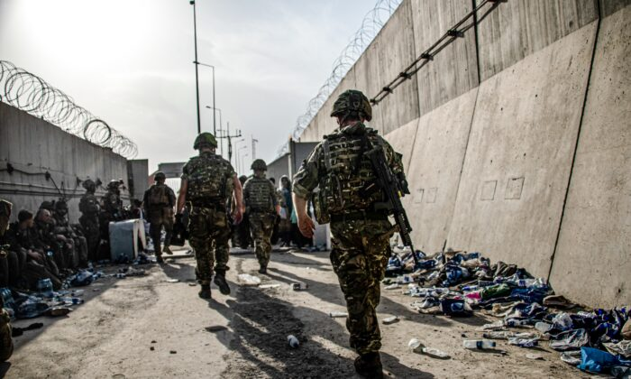 UK Armed Forces taking part in the evacuation of entitled personnel from Kabul airport, Afghanistan, on Aug. 23, 2021. (MoD/PA)