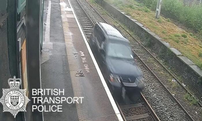 Aaron O'Halloran driving a car on railway tracks between Duddeston and Aston stations in Birmingham, UK, on May 9, 2021. (BTP/PA)