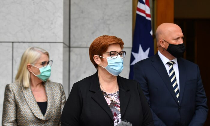 Minister for Foreign Affairs Marise Payne (C) and Minister for Defence Peter Dutton (R) at a press conference at Parliament House in Canberra, Australia, Aug. 27, 2021. (AAP Image/Mick Tsikas)