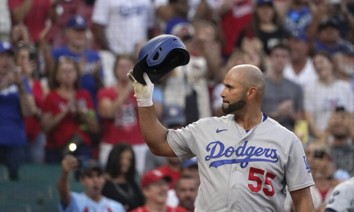 Los Angeles Dodgers' Albert Pujols tips his tap to cheering fans as he steps up to bat during the first inning of a baseball game against the St. Louis Cardinals in St. Louis on Sept. 7, 2021. (AP Photo/Jeff Roberson)