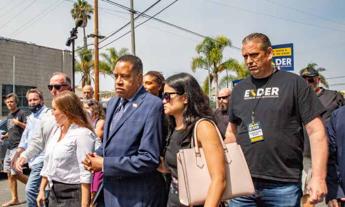 Larry Elder walks with staff and residents of Venice Beach, Calif., through streets with high populations of homeless individuals on Sept. 8, 2021. (John Fredricks/The Epoch Times)