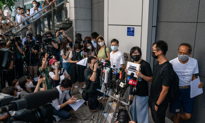 Hong Kong Alliance in Support of Patriotic Democratic Movements of China vice-chairwoman Tonyee Chow Hang-tung speaks to members of the media outside police headquarters in response to the National Security Department's request on allegations of foreign agents in Hong Kong, China, on Sept. 7, 2021. (Anthony Kwan/Getty Images)