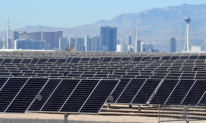 The Las Vegas Strip is shown behind solar panels during a dedication ceremony to commemorate the completion of the 102-acre, 15-megawatt Solar Array II Generating Station at Nellis Air Force Base in Las Vegas, Nevada, on Feb. 16, 2016. (Ethan Miller/Getty Images)