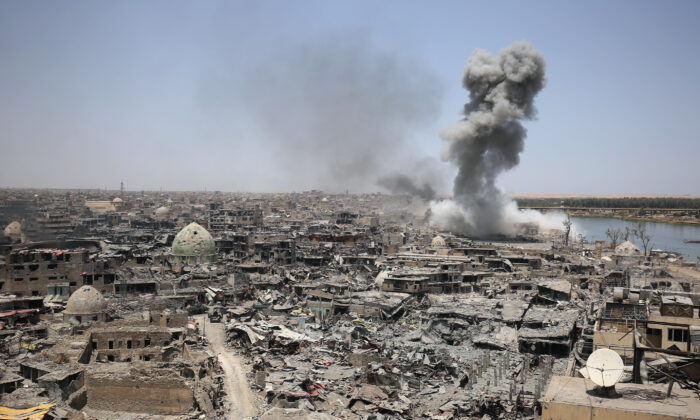 Smoke billows following an airstrike by U.S.-led international coalition forces targeting the ISIS terror group in Mosul, Iraq, on July 9, 2017. (Ahmad Al-Rubaye/AFP via Getty Images)