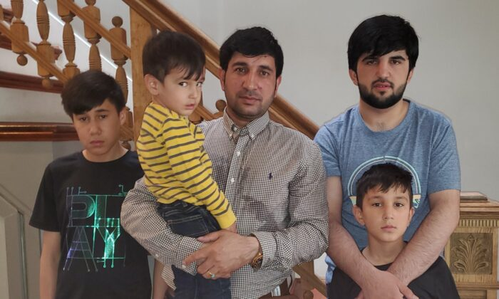 Mohammad Khalid Wardak and his children are seen on Sept. 7, 2021. (AP Photo).
