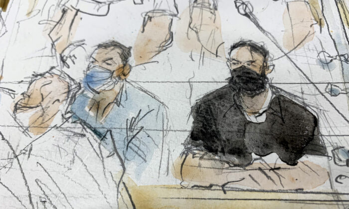 This sketch shows key defendant Salah Abdeslam, right, in the special courtroom built for the 2015 attacks trial in Paris, France, on Sept. 8, 2021. (Noelle Herrenschmidt/AP Photo)