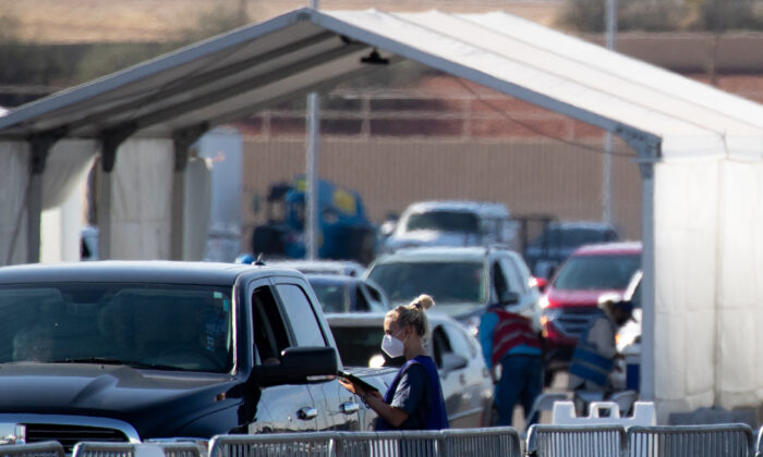 People wait after receiving a COVID-19 vaccine at State Farm Stadium in Glendale, Ariz., on Feb. 11, 2021. (Courtney Pedroza/Getty Images)