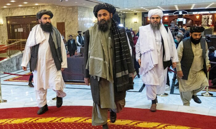 Mullah Abdul Ghani Baradar, the Taliban's deputy leader and negotiator, and other delegation members attend the Afghan peace conference in Moscow on March 18, 2021. (Alexander Zemlianichenko/Pool via Reuters)
