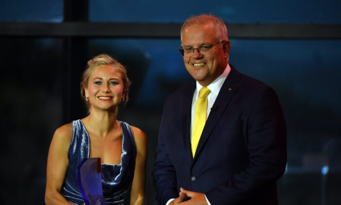 Prime Minister Scott Morrison and 2021 Australian of the Year winner Grace Tame during the 2021 Australian of the Year Awards at the National Arboretum in Canberra, Australia, on Jan. 25, 2021. (AAP Image/Mick Tsikas)