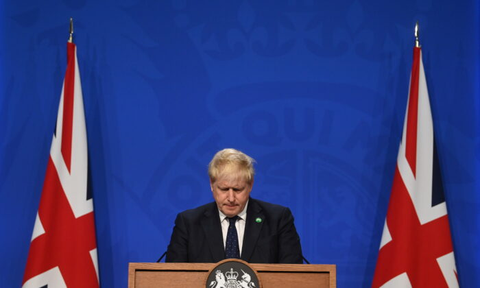 Britain's Prime Minister Boris Johnson speaks on his plan to raise taxes during a news conference in Downing Street in London, on Sept. 7, 2021. (Toby Melville-WPA Pool/Getty Images)