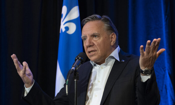 Quebec Premier Francois Legault responds to reporters questions over the federal election debate, in Quebec City on Sept. 9, 2021. (The Canadian Press/Jacques Boissinot)