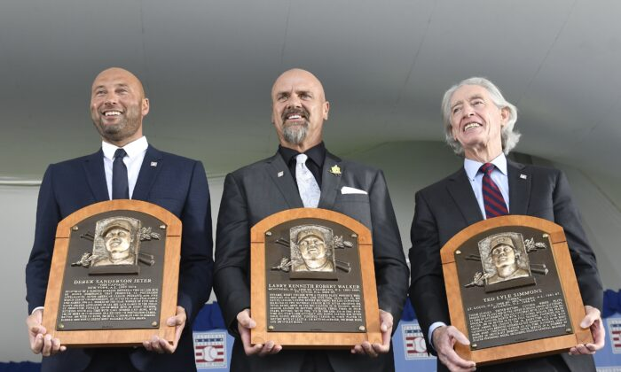 (L-R) Hall of Fame inductees Derek Jeter, Larry Walker, and Ted Simmons hold their plaques for photos after the induction ceremony at Clark Sports Center at the National Baseball Hall of Fame in Cooperstown, N.Y., on Sept. 8, 2021, (Hans Pennink/AP Photo)