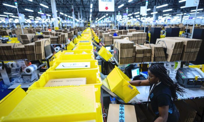 A woman works at a packing station at the 855,000-square-foot Amazon fulfillment center in Staten Island, one of the five boroughs of New York City, on Feb. 5, 2019. (Johannes Eisele/AFP via Getty Images)