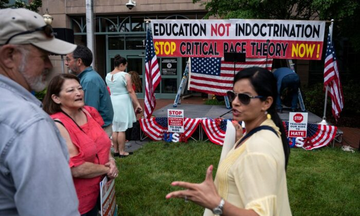 People talk before the start of a rally against critical race theory being taught in schools at the Loudoun County Government center in Leesburg, Va., on June 12, 2021. (Andrew Caballero-Reynolds/AFP via Getty Images)