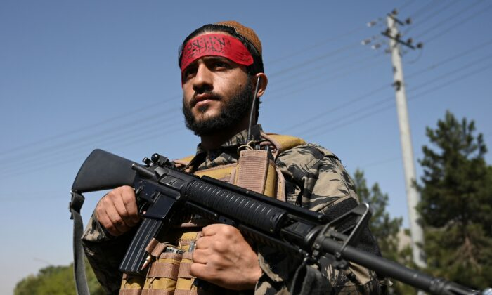 A Taliban fighter stands guard along a road in Kabul on Sept. 9, 2021. (Wakil Kohsar/AFP via Getty Images)