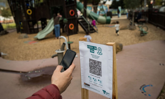 A parent uses the QR code check in at a playground in Brunswick in Melbourne, Australia, on Sept. 03, 2021. (Darrian Traynor/Getty Images)