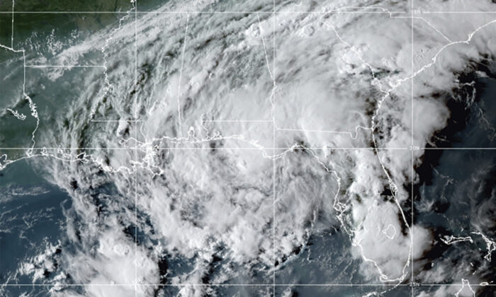 Tropical Storm Mindy as it makes landfall on the Florida Panhandle in this GOES- East GeoColor satellite image taken on Sept. 8, 2021, at 10:30 p.m. ET. (NOAA via AP)