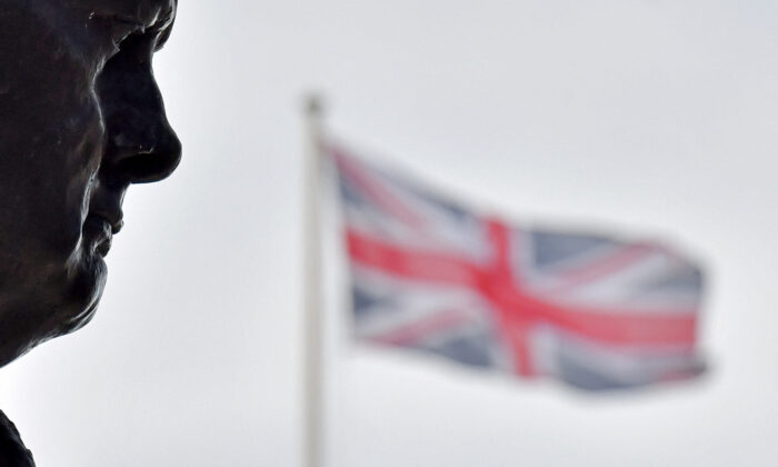 Union flags fly near a bronze statue of British war-time Prime Minister Winston Churchill, by sculptor Ivor Roberts-Jones, in Parliament Square in London, on May 11, 2021.  (Justin Tallis/AFP via Getty Images)